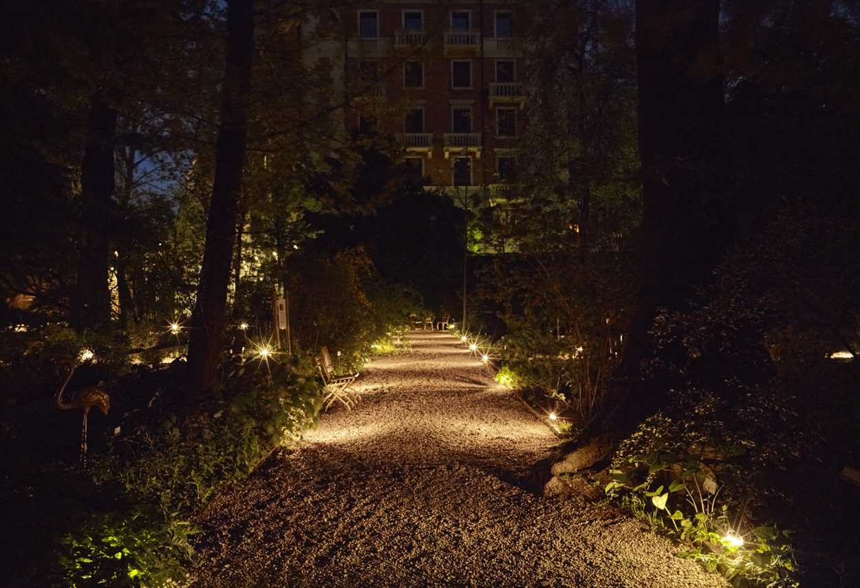 Italy Milan Brera Botanical Garden night view of main route - building lights
