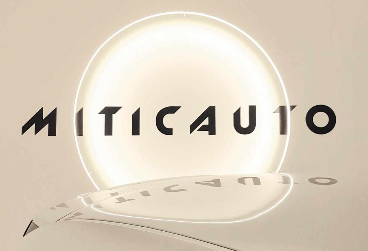 Showroom Miticauto logo and lamp - retail lighting design